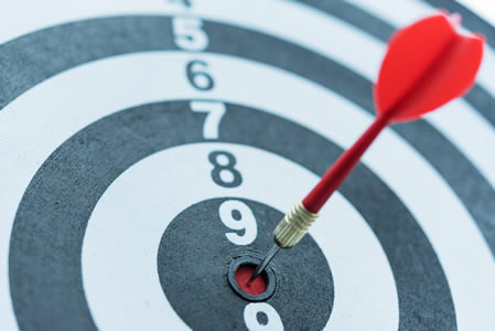 Target with dart hitting the bulls eye