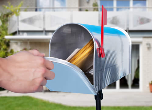 hand taking mail from mailbox