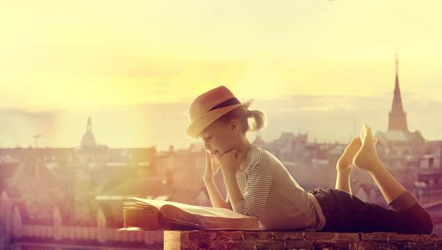 girl relaxing on a city rooftop, reading a book