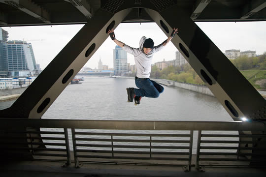 teen skater on a bridge