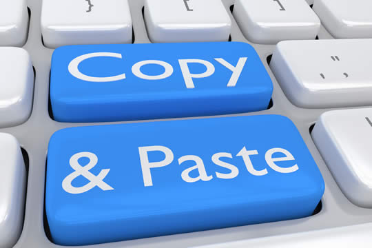 Keyboard keys labeled copy and paste