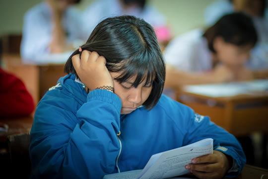Girl taking exam in class