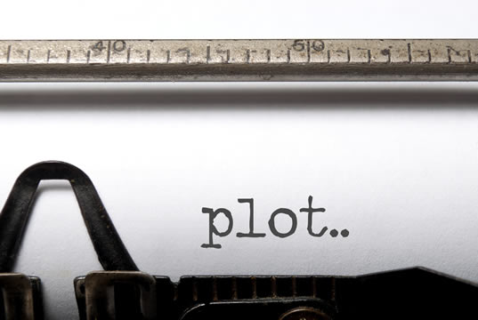 "sheet of paper in a typewriter, with the word ""plot"" typed on it"