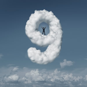 a person floating on cloud shaped like the number 9