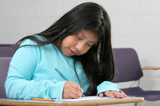 girl writing in class