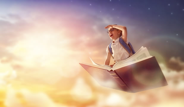 happy student flying atop a book, against background of sunset sky