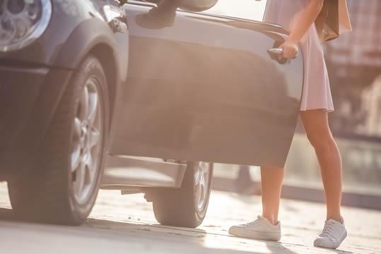 teen closing car door