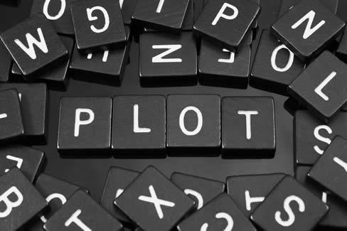 """word game letter tiles spelling the word """"plot"""""""