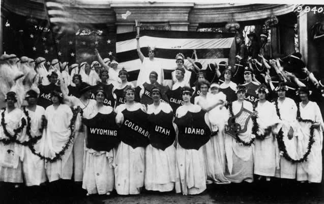 women suffragettes dressed in white