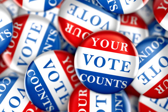 "Buttons with the slogan ""Your vote counts"""