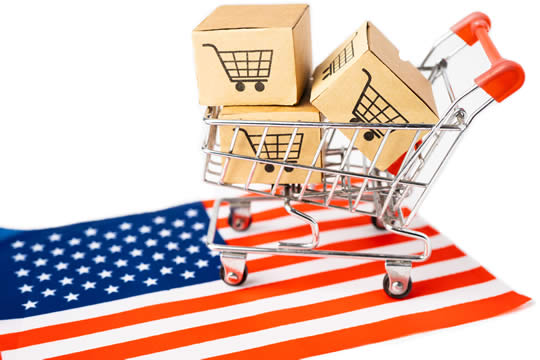 a shopping cart full of boxes on top of the American flag