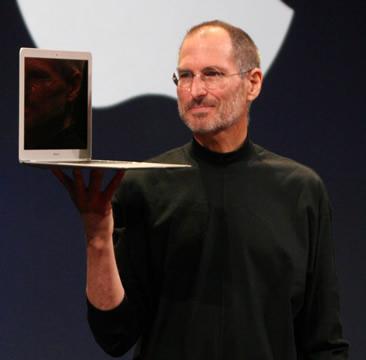 photo of Steve Jobs holding a MacBook Air laptop
