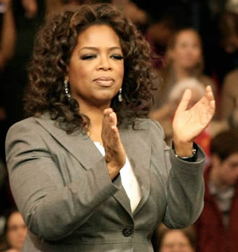 Oprah Winfrey standing in front of a television audience