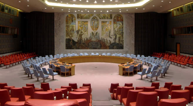 the Security Council chambers with empty chairs in semi-circle for delegates