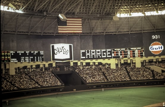 photo of the inside of the Astrodome showing the baseball field and the scoreboard