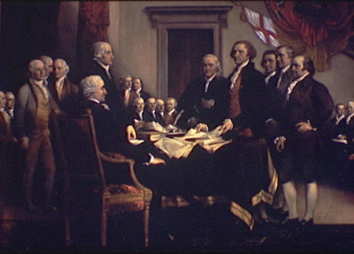 a group of men signing the Declaration of Independence at the Second Continental Congress