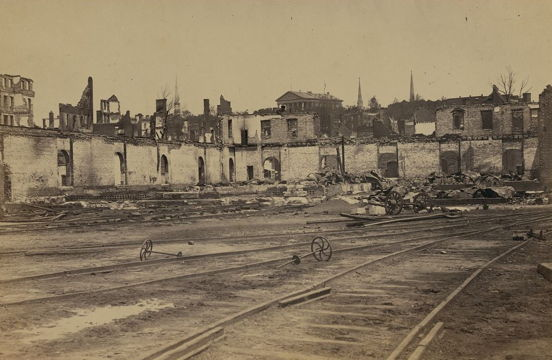 old photo of a train station that has been bombed