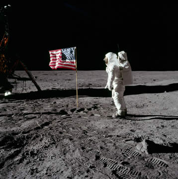 astronaut saluting American flag on the moon