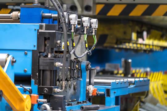 a close-up photo of a complex manufacturing machine