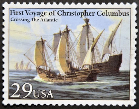 """American postage stamp showing the First Voyage of Christopher Columbus, captioned """"Crossing the Atlantic"""""""