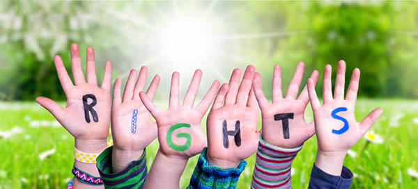 """children's hands raised with the word """"rights"""" written across the palms"""