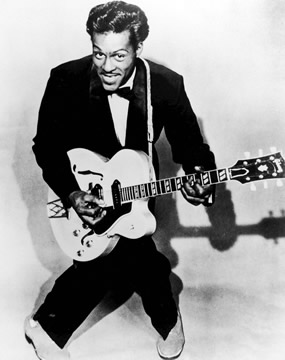photograph of rock & roll singer Chuck Berry holding his electric guitar